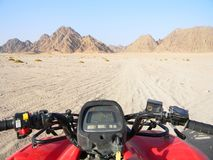 Quad bike in the desert race. All terrain vehicle or quadricycle view in the desert road. Stock Image