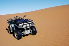 Quad bike on dune, Namibia Stock Photo