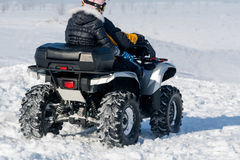Quad bike. In a field in winter Royalty Free Stock Photography