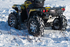 Quad bike. In a field in winter Stock Photos