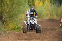 The quad bike is flying. SERPUKHOV, RUSSIA - OCTOBER 7, 2017: Morgunov Oleg 67,  Class ATV, in the 4 stage  MX series, the Red Wings Cup 2017 super country-cross Royalty Free Stock Photography