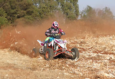 Quad Bike kicking up trail of dust on sand track during rally ra Stock Photos