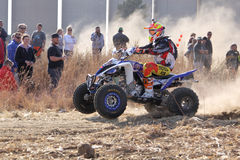 Quad Bike kicking up trail of dust on sand track during rally ra Stock Photography