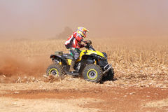 Quad Bike kicking up trail of dust on sand track during rally ra Stock Photo