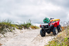 Quad bike parked on the sandy pathway Royalty Free Stock Image