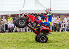 Quad bike pulling a wheelie. Royalty Free Stock Images