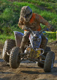 Quad bike race. Racing with quad bike in mud Royalty Free Stock Image