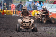 Quad bike racing in dirt and mud. Two quad bikes racing in dirt and mud Royalty Free Stock Images