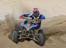 Quad Bike Racing on Sand Stock Photo