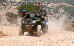 Quad bike runner sliding Stock Images