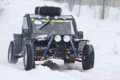 The quad bike's drivers ride over snow track Stock Photos