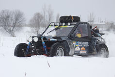 The quad bike's drivers ride over snow track Stock Photo