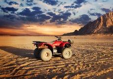 Quad bike in sand desert Royalty Free Stock Images