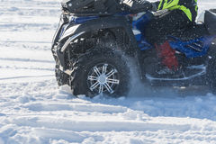 Quad bike in snow. Front wheel of Quad bike in the snow Royalty Free Stock Photos