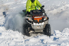Quad bike in snow. Front wheel of Quad bike in the snow Royalty Free Stock Image