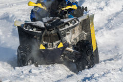 Quad bike in snow. Front wheel of Quad bike in the snow Stock Photo