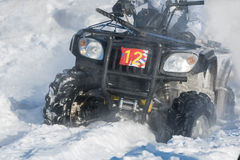 Quad bike in snow. Front wheel of Quad bike in the snow Stock Image