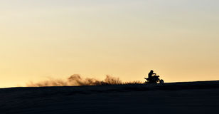 Quad bike in the sunset Royalty Free Stock Photo