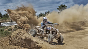 Quad bike throws up dust on a corner Royalty Free Stock Photo
