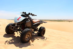 Quad bike the white sand dunes mui ne veitnam Stock Photo