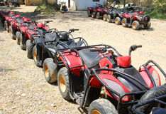Quad bikes atv in row Stock Images