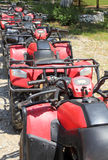 Quad bikes atv in row Royalty Free Stock Photo