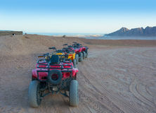 Quad bikes in the desert in front of the mountains Stock Photo