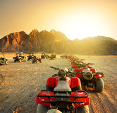 Quad bikes in desert Stock Photos