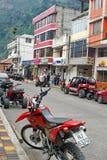 Tour vehicles parked in Banos, Ecuador Stock Photo