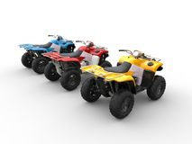 Quad bikes in primary colors - red, blue and yellow Royalty Free Stock Photography
