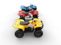Quad bikes in primary colors - red, blue and yellow Stock Photography