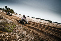 Quad bikes racing. On dirt track Royalty Free Stock Photo