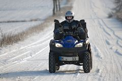 Quad biking. Active senior moves in the winter with the quad Stock Photo
