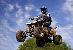 Quad blue jump Stock Photo