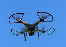 Quad Copter Drone on a blue background Royalty Free Stock Photos