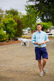 Quad Copter Pilot Flying Drone at Wedding Royalty Free Stock Photography