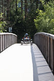 Quad driving over bridge, Lienz, Austria Stock Images