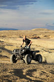 Quad in hills - teen on four wheeler Stock Image