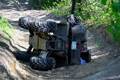 A quad on its side after it has been accidentally flipped.  Stock Image