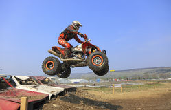 Quad jump. Cluj Napoca,Romania, 11 April 2009 -Image of a quad rider jumping over an obstacle made of old cars during the ?Can-Am Vaneaza Lupul 2009? race Stock Photos