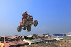 Quad jump. Cluj Napoca,Romania, 11 April 2009 -Image of a quad rider jumping over an obstacle made of old cars during the Can-Am Vaneaza Lupul 2009 race Stock Photography