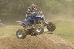 Quad jump (Young boy on a quad) Royalty Free Stock Photo