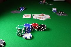 Quad Kings - Action shot on a poker table. Kings begin thrown onto the 3 flopped cards Royalty Free Stock Photos