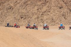 Quad motorbike safari in Sinai desert, Sharm el Sheikh, Egypt, a trip on the quadrocycles of the mountain of Sinai. Quad motorbike safari in Sinai desert, Sharm Royalty Free Stock Photos