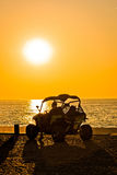 Quad motorbike by the sea at sunset Stock Photo