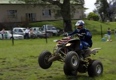 Quad Racer. A Quad racer showing off, motion blur Stock Photography