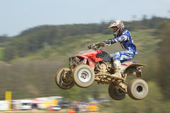 Quad racer in blue is jumping Royalty Free Stock Images