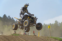 Quad racer with camera on helmet is jumping Stock Images