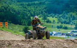 Quad racer. On a hill.  Event from 20.05.2015 in Moreni, Dambovita, Romania Stock Photography