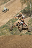 Quad racer is jumping Royalty Free Stock Images